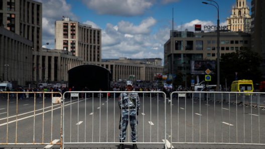 A serviceman of Russia's National Guard secures an area during a rally organised by Union of Journalists in Moscow